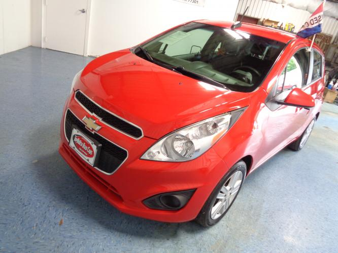 2015 RED Chevrolet Spark LS CVT (KL8CB6S96FC) with an 1.2L L4 16V DOHC engine, Continuously Variable Transmission transmission, located at 900 East Davis Street, Conroe, TX, 77301, (936) 539-9909, 30.314880, -95.446770 - Photo #0