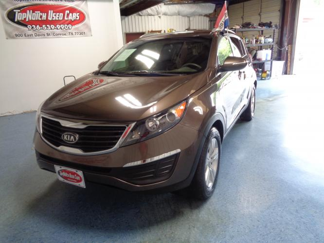 2011 BROWN Kia Sportage LX FWD (KNDPB3A25B7) with an 2.4L V6 DOHC 24V engine, located at 900 East Davis Street, Conroe, TX, 77301, (936) 539-9909, 30.314880, -95.446770 - Photo #0
